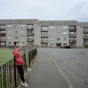 Leah in front of her flats 2016