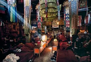 Lhasa, Tibet: Monks worshipping the deities during the July full moon in the monastery pray night and day with no pauses. © Matjaz Krivic