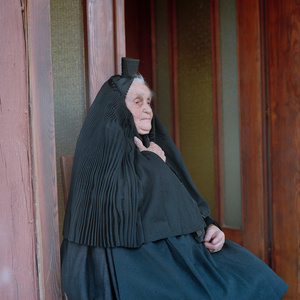 Anna Katharina Suessmann (b. 1923) in her special veil for mourning at funerals, Schwalm, Hessia, Germany, 2011. From the series: Village Queens. The last women in their traditional peasant garbs