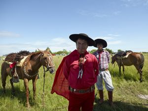 Gauchito Gil father and son devotees with their horses at the national gathering in Mercedes town for  the celebrations of January 8, date of the murder of the popular saint