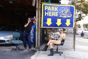Park Here on Varkick. From the series, Nue York: Self-Portraits of a Bare Urban Citizen, © Erica Simone