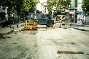 Turkish riot police street tank in front of barricades during anti-government demonstration in Gazi neighbourhood in Istanbul, Turkey.