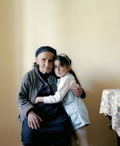 UNRECOGNIZED REPUBLIC OF NAGORNO-KARABAKH / Shushi / 16.05.2012. Nora Eremian (born 1930) with her great-granddaughter. Her two sons have become victims of the Karabakh war: One of them is reported missing, the other one was killed.