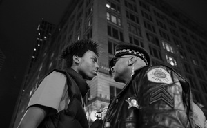 Lamon Reccord stares down a police sergeant during a protest following the fatal shooting of Laquan McDonald by police in Chicago, Illinois, USA, 25 November 2015.