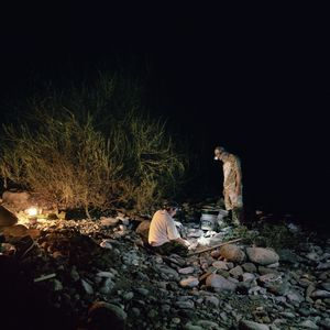 Adolf and Martin go night prospecting, Klamath National Forest, California, 2010. © Sarina Finkelstein