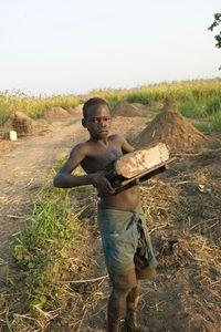 © 2014, Stephen Shames — Uganda. Making bricks.
