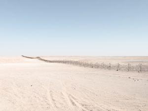 Graziani's Fence (270 kilometer barbed-wire fence), near Jaghbub, Libya | © Matthew Arnold Photography