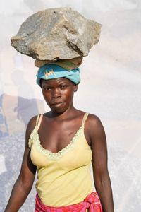 Apiyo Jennifer: Earns 1,000 shillings ($0.32) per Jerrycan of gravel.