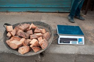 © Iva Zimova. Aleppo. Pieces of firewood being sold on the street with a set of scales to measure their weight. Aleppo has been experiencing lengthy electricity outages and wood is often the only way to cook and heat for many residents.