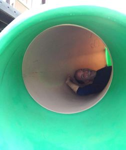 Steve in a slide at the park