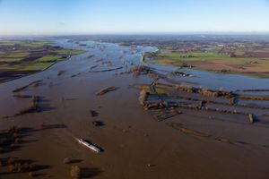 "River IJssel at high waters, flooded forelands. From the book ""The Low Land"" © Siebe Swart"