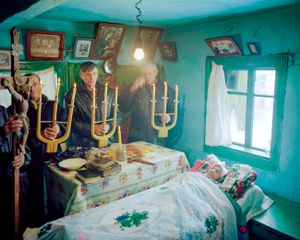 Karpatskoye, Ukraine, 2009. Funeral of an old lady Anna at her house.