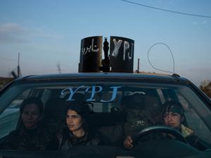 SYRIA. Serikani. Rojava. YPJ members sitting in an armed vehicle in Serikani.