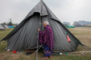 An old woman lives in a makeshift camp who have lost her house in the eartquake at Katmanmdu, Nepal, 7 May 2015