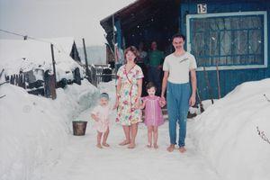 Pjotr with his family, Apanas Siberia, 1993 © Bertien van Manen, in camera galerie