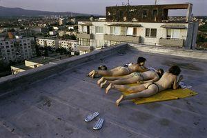 Girls taking a sunbath, Pezinok, 2004. © Andrej Balco