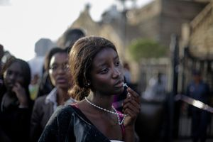 1st Prize People – Observed Portraits Single. A woman reacts in disappointment after access to see former South Africa President Nelson Mandela was closed on the third and final day of his casket lying in state, outside Union Buildings in Pretoria, South Africa © Markus Schreiber, Germany, The Associated Press