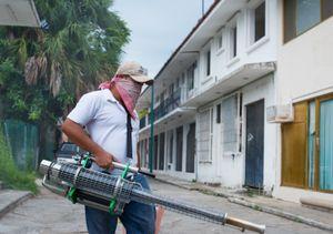 Roberto fumigating residentialareas, after a Dengue alert. Ixtapa.