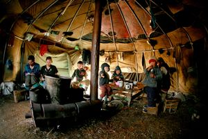 Children having lunch in Even teepee. Bulunskiy ulus. August, 2008 © Evgenia Arbugaeva