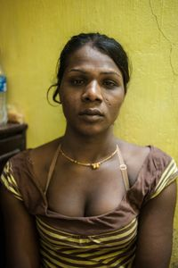 """Kajal, a 20-year-old hijra, lives near King's Circle Station.  When she became a hijra three years ago, her family forced her out of the family home in southern India.  She told me, """"I became a sex worker because it was the only way I could make enough money to pay for rent and food"""".  © Alison McCauley"""