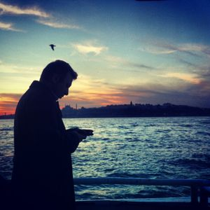 A man silhouette in front of Bosphorus.