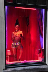 "Documentation of intervention, Red Light District, Amsterdam. From the series ""Being (T)here"" © Zanele Muholi, courtesy of Huis Marseille"
