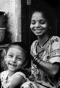 Laughing Girl And Grinning Mother