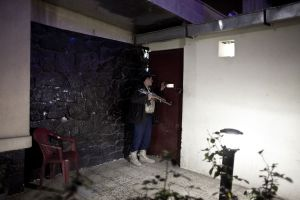 The security guard at the entrance of the Blue Flame | Kabul, Afghanistan 2012 © Sandra Calligaro