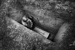 The burial of the eight-month-old Sakura Lisi, the daughter of a gold miner in Mongbwalu, northeastern Congo. 2004.