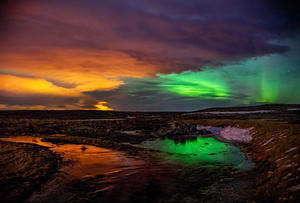 Northern lights and city lights, Hella, Iceland, 2016.