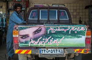 "Drivers scribble poems on the rear of their vehicles so the ""environment agents"" (border police) do not block their way on the road. Here, a smuggler has written, ""I am the lord of Baluchistan. I am in the desert day and night. Although I'm carrying diesel, do not shoot me because I am young."" © Sadegh Souri"