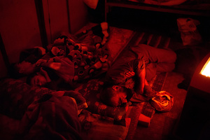 Ezidiar, Serdesht and Saïd sleep on the floor of the shipping container the family calls home. 19/02/15.