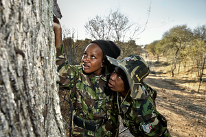 Black Mambas Felicia & Joy checking  camera traps