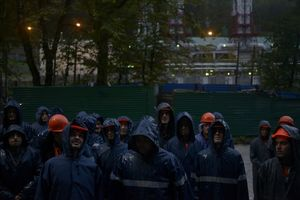 Workers get  morning brief  for the  working  day   on  the  construction  site in Laura ski resort.