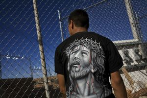 A man who has just been returned to Mexico after trying to illegally enter the US stands just across the border at a Mexican customs and immigration office in Nogales, Sonora. © David Rochkind
