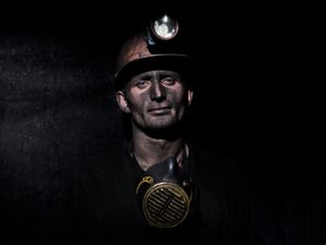 Portrait of a coal miner just came back from work.
