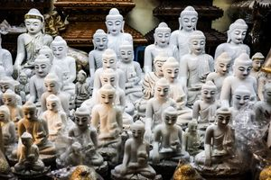 Buddha statues that are sold in shops.