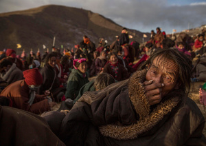 Tibetan Buddhist nomads listen during the annual Bliss Dharma Assembly in Sertar county, Garze Tibetan Autonomous Prefecture, Sichuan province, China, 31 October 2015.