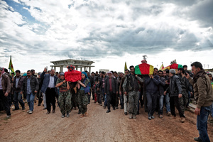 14 April, 2015: A group of YPJ (Women's Protection Units) and YPG (People's Protection Unit) fighters carry the coffins of Kurdish fighters who were killed during clashes with the Islamic State in Eastern frontline of Kobane, Syria.