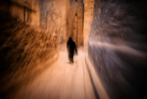Thulla, Yemen: A woman is walking through the narrow streets of historical town. © Matjaz Krivic