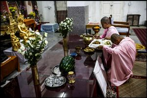 Nuns are in prayer In Buddhist temple _  Yangon