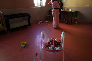 """Casablanca, March 2015. The nursery of the NGO """"Solidarité Feminine"""". I., 18 years old , end of the day , after work she returns home with her baby."""