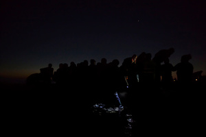 Refugees travel in darkness through Europe to avoid detection; Lesbos, Greece, 06 December 2015.