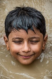 The homeless children. Happy for  the rare shower.