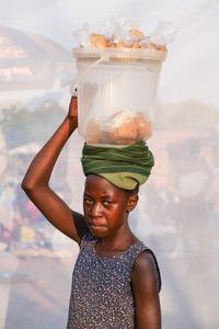 Apiyo Pamella : Sells g-nut paste for 1,000 shillings ($0.32) per bag.