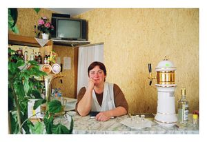 The owner of Nijole's pub- Nijole, October 2002 © Mindaugus Kavaliauskas