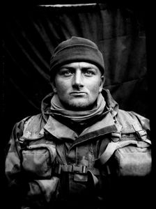 """KABUL PORTRAITS. """"Private first class Wesley, scout"""". Portraits of Dutch ISAF troops in Kabul, Afghanistan. The photos are taken with the antique box camera, borrowed from an Afghan street photographer in Kabul. The exposure time of each photo was 10 seconds."""