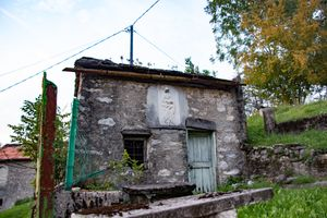 Holy Mary with son on the wall of a rural house near the lake of Como