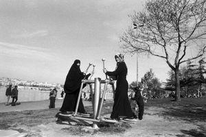 Two women use the exercise machines in a park in the Fener district.