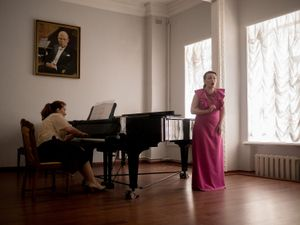 A young singer during a recital at the music school of Donetsk.